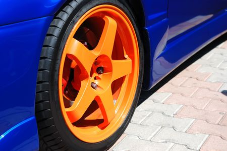 Close up of a yellow wheel of the sports car Stock Photo - 5600702