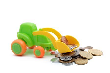 honorarium: The toy excavator loads money on white background