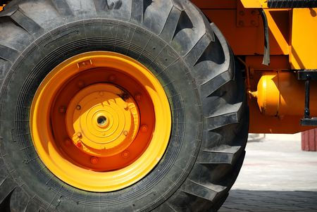 The big yellow wheel of new heavy technics photo