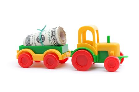 honorarium: The toy tractor transortation money on white background
