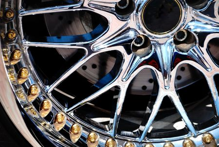 Closeup the chromeplated rim of a wheel Stock Photo - 5800203