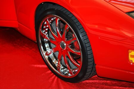 The chromeplated wheel on a red fabric photo