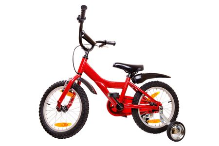training wheels: New red childrens bicycle isolated on white background