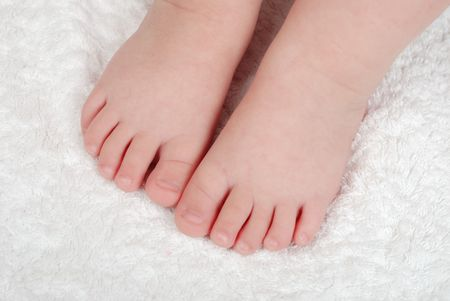 Childrens legs on a soft light towel photo