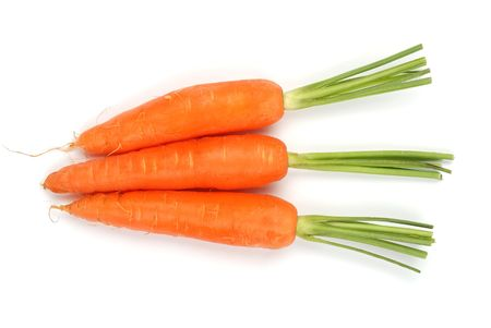 Three carrots isolated on a white background photo