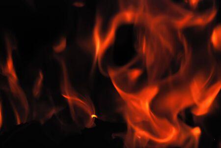 smoldering: Closeup of the burning flame on dark