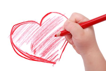 Childrens hand with pencil draws the heartl, isolated Stock Photo - 6253887