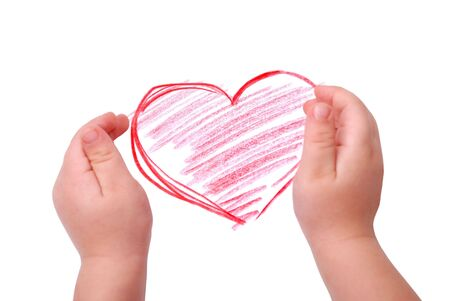 The children's hands is located in heart drawing, isolated Stock Photo - 6324543