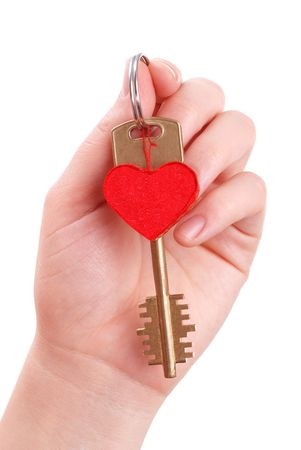 The woman hand holds a key to heart on white photo
