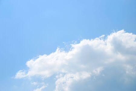 Fantastic soft white clouds against blue sky photo