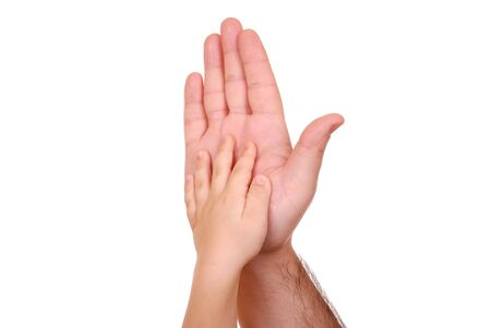 infant hand: Hand shake of the child and father isolated