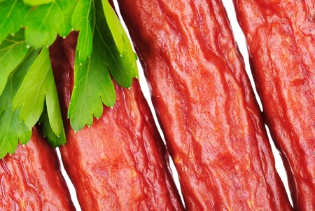 Group of tasty sausages with parsley leaf photo