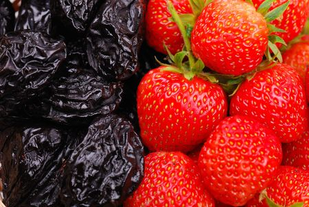 prune: Background from fresh strawberry and prune
