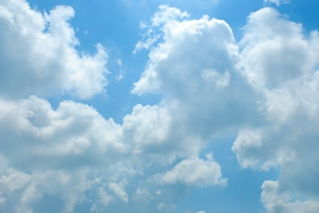 midday: Bright sunny clouds against midday blue sky
