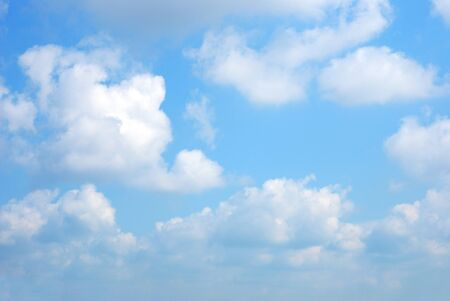 midday: Bright soft clouds against midday blue sky Stock Photo