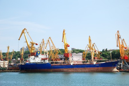 View on trading seaport with cranes, cargoes and the ship Stock Photo - 7345232