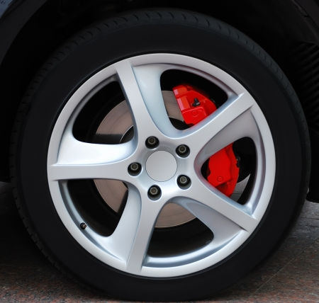 Close up of a car wheel with red brake Stock Photo