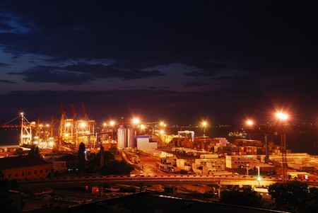 Port warehouse with cargoes and containers at night Stock Photo - 7345235