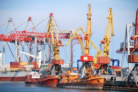 maritime: View on trading seaport with cranes, cargoes and the ship Stock Photo