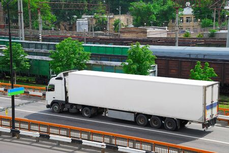 Transportation of cargoes by lorry and railroad photo