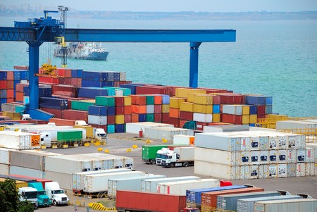 Port warehouse with containers and industrial cargoes Stock Photo - 7375432