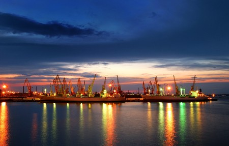 container port: Port warehouse with cargoes and containers at night