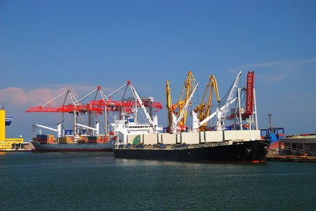 sea port: View on trading seaport with cranes, cargoes and the ship Stock Photo