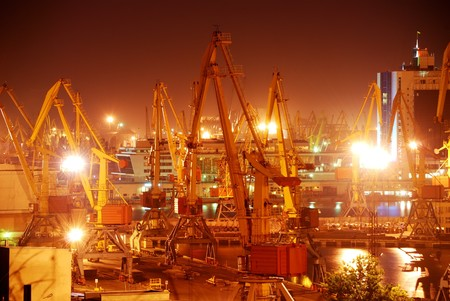 Port warehouse with cargoes and containers at night Stock Photo - 7434078