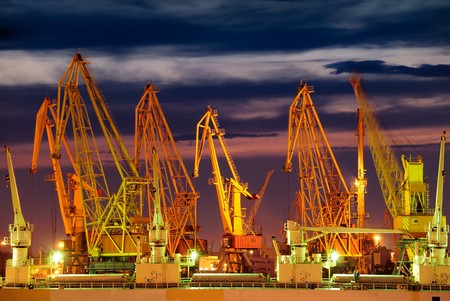 Port warehouse with cargoes and containers at night Stock Photo - 7434080