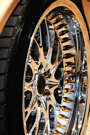 Closeup of the golden wheel and tyre cover