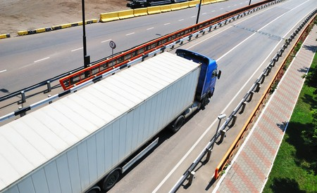 Transportation of cargoes in containers by lorry photo