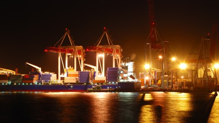 Port warehouse with cargoes and containers at night Stock Photo - 7526583