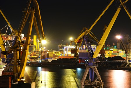 Port warehouse with cargoes and containers at night Stock Photo - 7557208