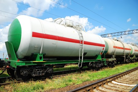 Set of tanks with oil and fuel transport by rail photo