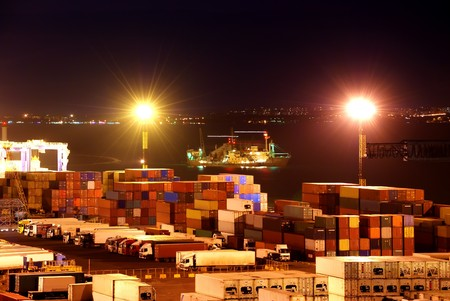 Port warehouse with cargoes and containers at night Stock Photo - 7704010