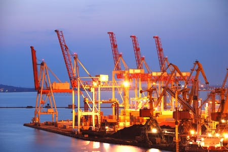 Port warehouse with cargoes and containers at night