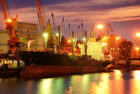 cargo ships: Port warehouse with cargoes and containers at night