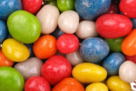 Background from multicolored sweets covered with glaze photo