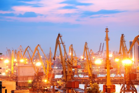 Port warehouse with cargoes and containers at sunset Stock Photo