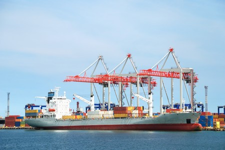 View on trading seaport with cranes, cargoes and the ship Stock Photo - 7876867