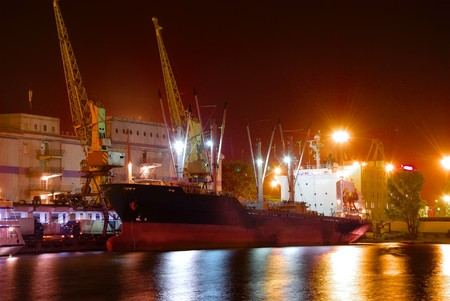Port warehouse with cargoes and containers at night Stock Photo - 7913191