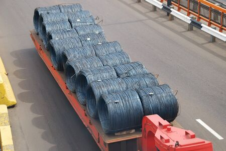 Transportation of metal products on road photo
