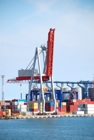 Port warehouse with containers and industrial cargoes photo