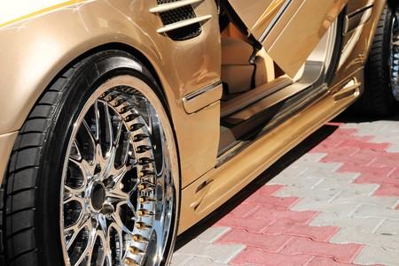 custom car: The golden car with an open door