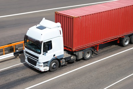truck road: Transportation of cargoes in containers by lorry
