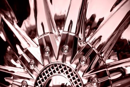 Stylized image of sportcar chromeplated wheel photo