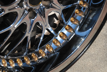 Closeup the chromeplated rim of a wheel