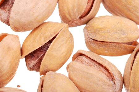 pistachios nuts isolated on white photo