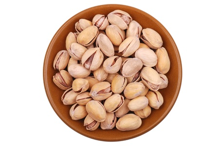 Handful of pistachios nuts isolated on white photo