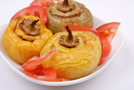 Stuffed paprika and pepper on a plate isolated photo